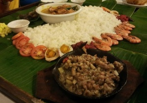 Eating off banana leaves in the Philippines